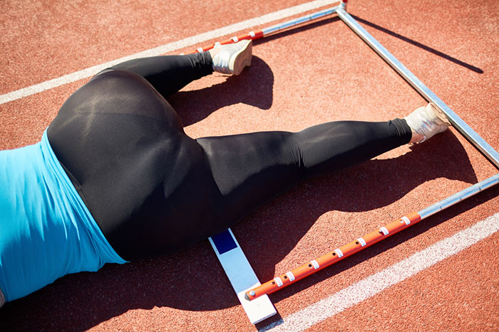 Image of runner laying on the ground